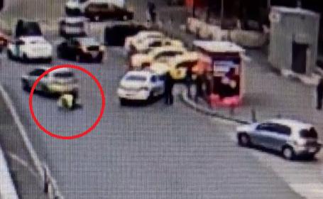 Politist lovit cu mașina