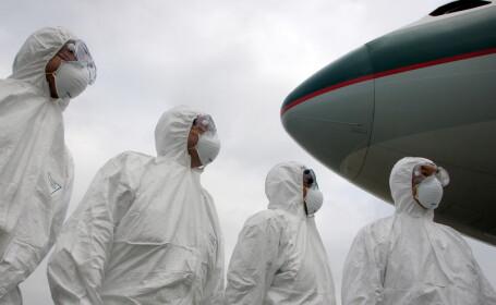 oameni in costume de protectie, epidemie, virus