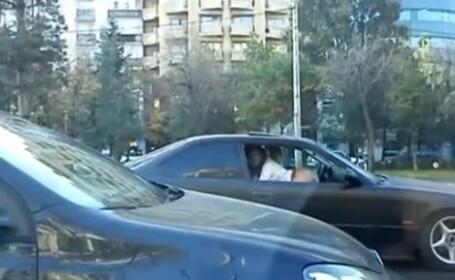 O tanara, gata sa provoace accidente in Capitala. Ce facea intr-o masina, pe jumatate dezbracata