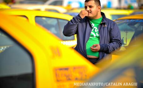 taximetrist cu burta care mananca seminte