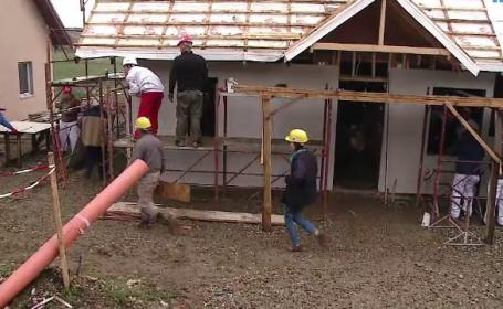 33 de manageri europeni construiesc case pentru familii nevoiase, in Cluj. \