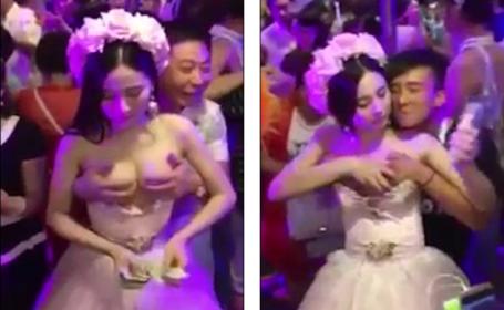Mireasa din China filmata in timp ce-i lasa pe nuntasi sa-i atinga bustul contra cost. Cum a reactionat mirele. VIDEO