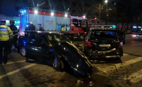 Impact violent între două mașini de lux, într-o intersecție din Iași, FILMAT. Tânără de 17 ani, în comă