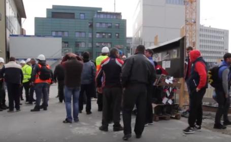 Zeci de muncitori români, angajați pe un șantier din Germania, lăsați pe drumuri și fără salarii