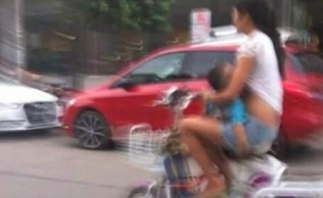 Gestul inconstient al unei mame din China. Ce facea cu bebelusul ei, in mijlocul strazii