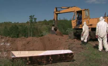 cimitir, excavator
