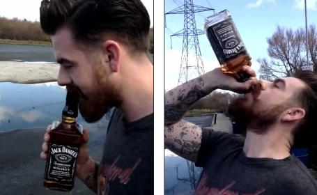 Un barbat isi risca viata si bea o sticla intreaga de Jack Daniels in doar 10 secunde. VIDEO