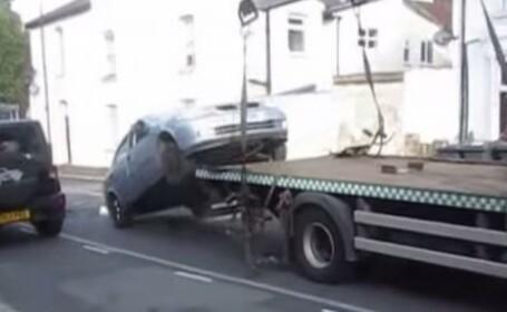 VIDEO Londra: Cum isi recupereaza un sofer masina ridicata pentru parcare ilegala: \