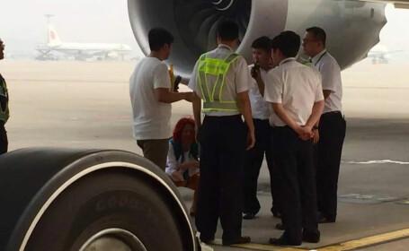 chinezi pe pista aeroportului