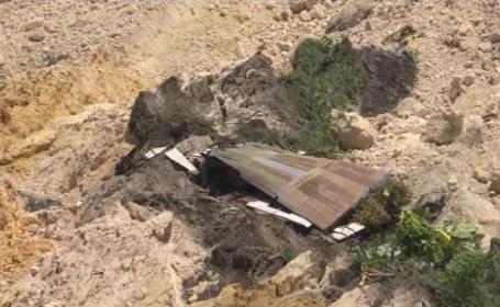 Două sate îngropate de alunecări de teren. Mesaje de ajutor trimise de sub pământ