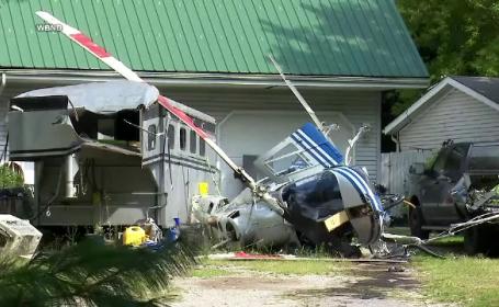 Momentul în care un elicopter s-a prăbușit pe aleea din faţa unei case