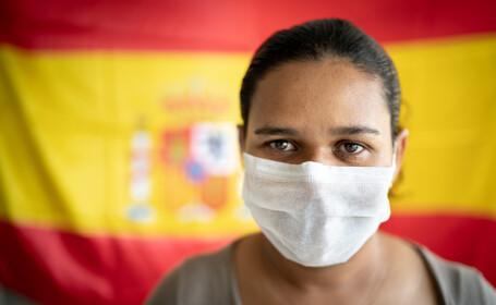 Femeie cu mască, Spania