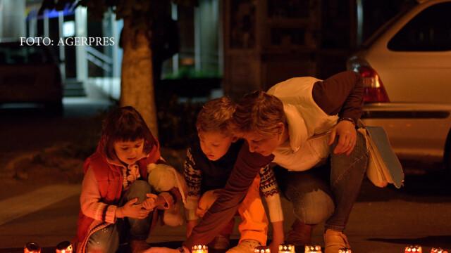 Obicei unic la Targoviste, in Joia Mare. Ce simbolizeaza candelele rosii aprinse de credinciosi