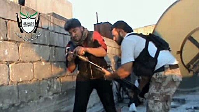 Inregistrarea VIDEO a unei zile de razboi in Siria. Batalia pentru un cartier din orasul Homs
