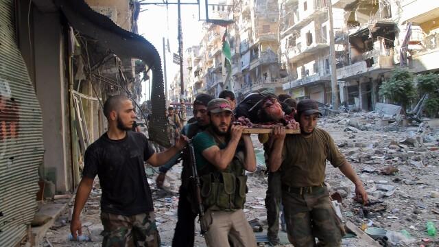 Noul presedinte din Iran vrea sa intermedieze negocieri intre Bashar al-Assad si rebelii din Siria - Imaginea 5