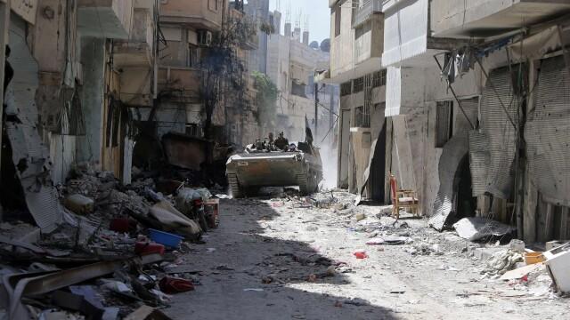 Noul presedinte din Iran vrea sa intermedieze negocieri intre Bashar al-Assad si rebelii din Siria - Imaginea 7