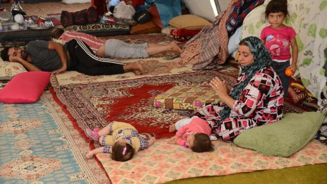 Statul Islamic aduce iadul pe pamant. Irakienii refugiati le dau copiilor sa bea sange pentru a-i mentine in viata - Imaginea 1