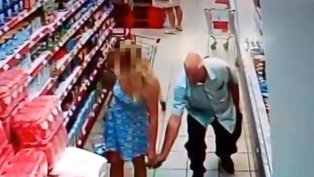 Barbat surprins in timp ce facea poze pe sub rochiile femeilor, intr-un supermarket. Ce a facut un agent de la securitate