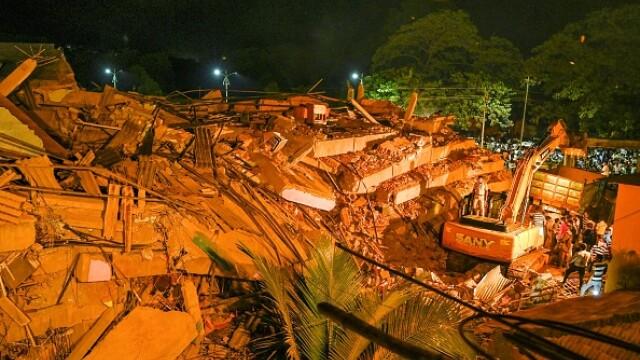 VIDEO. Un bloc de cinci etaje s-a prăbușit în India. Peste 90 de persoane, prinse sub dărâmături - Imaginea 2