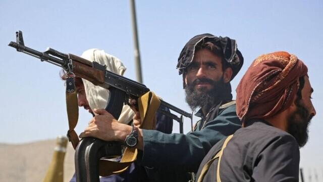 Talibanii sărbătoresc plecarea trupelor americane din Afganistan, sfârşitul unui război devastator de 20 de ani - Imaginea 8