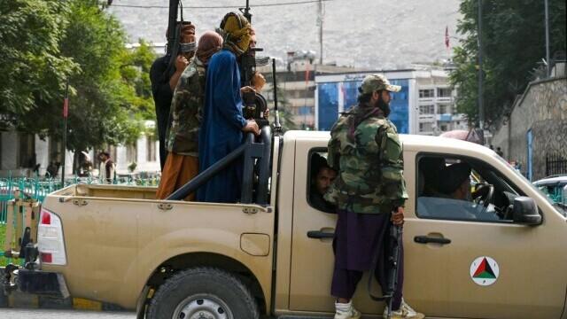 Talibanii sărbătoresc plecarea trupelor americane din Afganistan, sfârşitul unui război devastator de 20 de ani - Imaginea 11