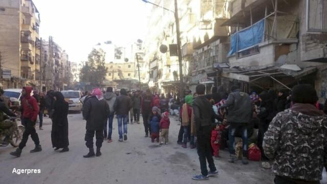 Primele evacuari din Alep au inceput. Mii de copii, femei si raniti sunt transportati cu autobuzele si ambulantele