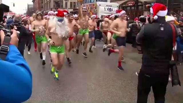 Cursă specială de Crăciun. Cât au plătit oamenii pentru a alerga în costum de baie - Imaginea 1