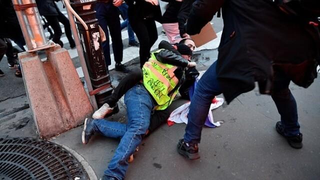 Protest violent în Paris. Vestele galbene s-au alăturat manifestanților. GALERIE FOTO - Imaginea 8