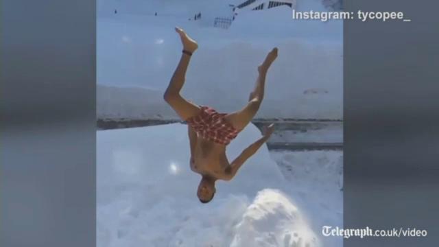 Distractie periculoasa in orasul Boston, acoperit de zapada. Primarul i-a avertizat pe tinerii care se amuza asa: E o prostie