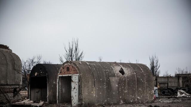 Apocalipsa din estul Ucrainei. Peisajul dezolant din Donetk aduce aminte de sfarsitul celui de-Al Doilea Razboi Mondial. FOTO - Imaginea 11
