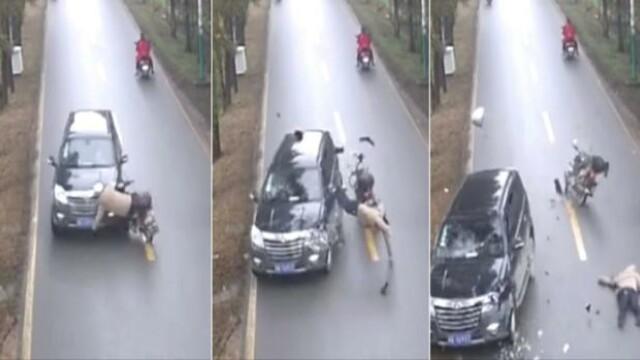 Momentul in care un motociclist chinez este izbit in plin de o masina. Detaliul care i-a salvat viata