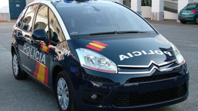 Trei romani acuzati de furtul a 23 de masini, arestati in Spania