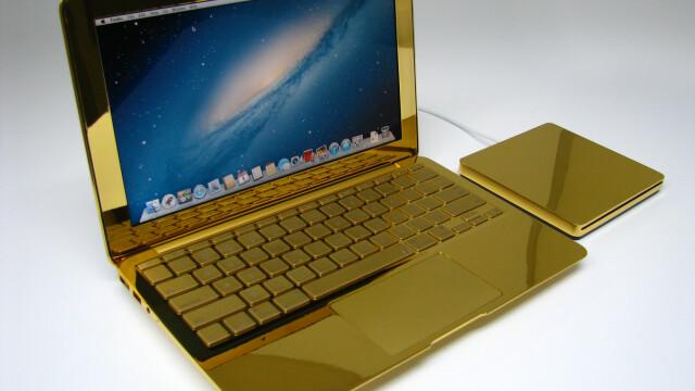 laptop placat cu aur