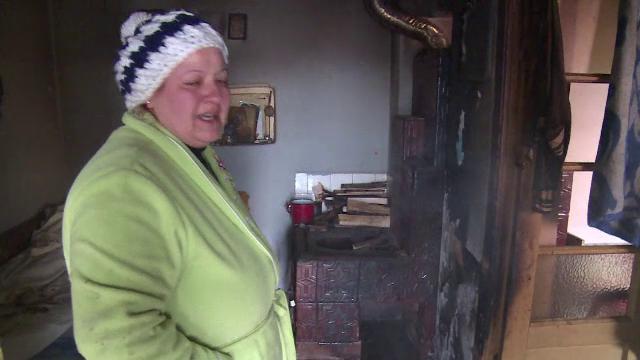 O bătrână a murit, după ce a umplut soba până la refuz cu lemne