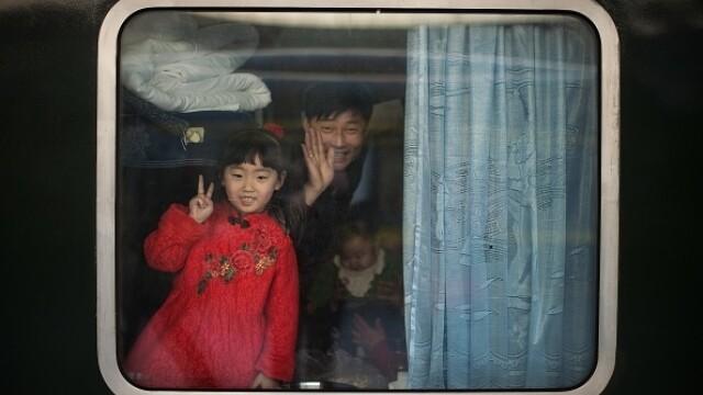 """A început """"cea mai mare migrație umană"""". Chinezii se întorc acasă de Anul Nou - Imaginea 1"""