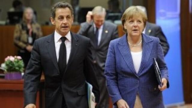 Merkel si Sarkozy dau, astazi, examen in fata Europei. Zona euro ameninta economia globala