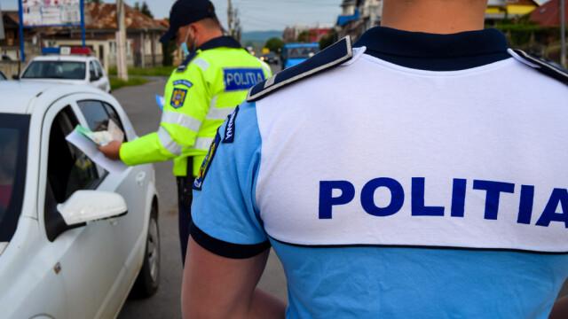 Un șofer a fost împușcat de polițiști. A încercat să lovească un agent cu mașina