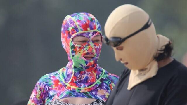 """Țara în care femeile poartă pe cap masca """"Facekini"""" pentru a nu se bronza deloc. GALERIE FOTO - Imaginea 12"""