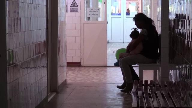 copil torturat