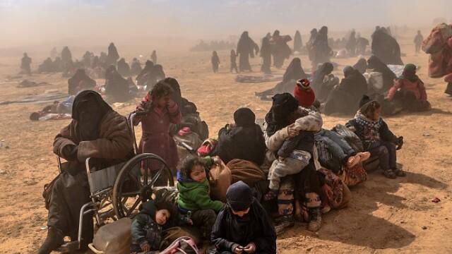Ultimii jihadişti ISIS, printre care copii şi invalizi, dau bătălia finală. GALERIE FOTO - Imaginea 1