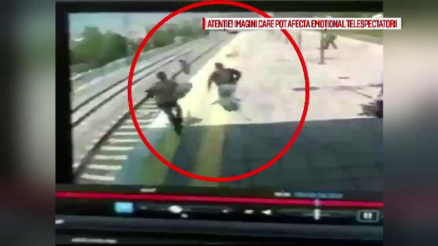 Momentul în care o tânără este salvată în ultimele secunde din fața unui tren