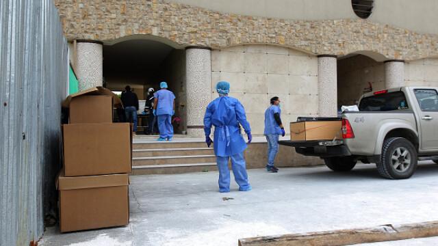 Sute de cadavre depozitate pe străzi sau pierdute în spitale și morgi într-un oraș din Ecuador. GALERIE FOTO - Imaginea 12
