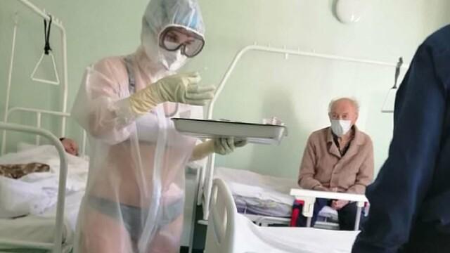 Ce s-a întâmplat cu asistenta care a tratat pacienții cu Covid-19 în lenjerie intimă. Prima reacție a rusoaicei - Imaginea 4