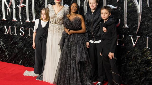 Cum arată fiica Angelinei Jolie și a lui Brad Pitt după tratamentul pentru schimbarea de sex - Imaginea 14