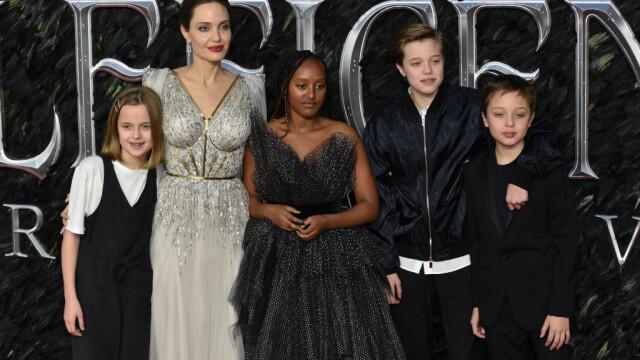 Cum arată fiica Angelinei Jolie și a lui Brad Pitt după tratamentul pentru schimbarea de sex - Imaginea 8