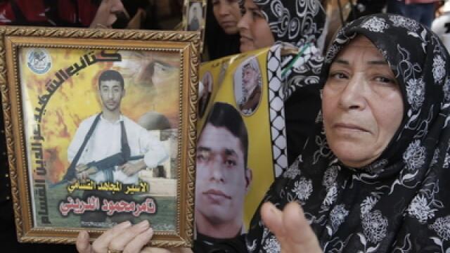 Schimb istoric de prizonieri. 1.027 de detinuti palestinieni pentru un militar israelian - Imaginea 1