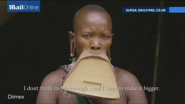 Femeia cu cea mai spectaculoasa podoaba faciala din lume. Si-a pus in buza de jos un disc de 19 centimetri si jumatate - Imaginea 1