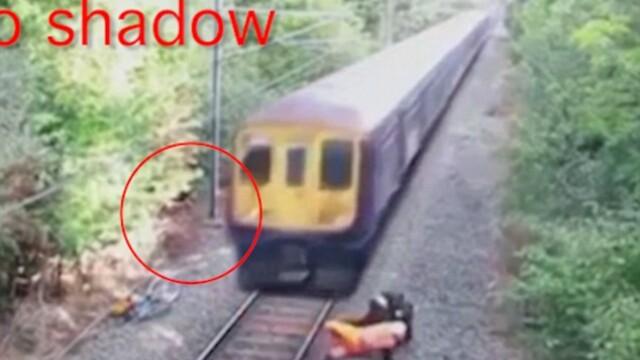 Un clip urmarit de milioane de oameni, in care un barbat este salvat miraculos din fata unui tren, este de fapt un fals