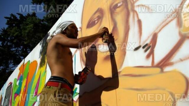 Graffiti antiviolenta in centrul Pitestiului
