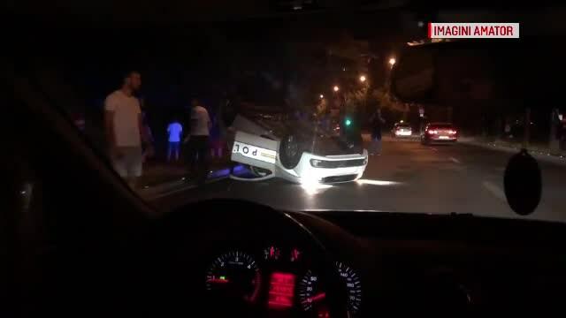 masina de politie rasturnata